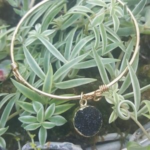 Gold bracelet with a black druzy